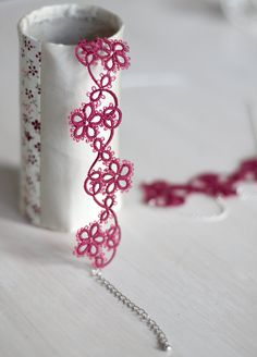Bracelet of tatting. Cute.
