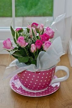 Bouquet of pink roses in a giant spotty pink tea cup. Could easily make your own on a budget as a lot of garden centres or The Range sell these giant tea cup and saucers and supermarkets sell nice bouquets for a fraction of what you'd pay at flower stores Spring Flower Arrangements, Spring Flowers, Floral Arrangements, Pink Tea Cups, Colorful Roses, Deco Floral, Table Centerpieces, Centrepieces, Tea Party