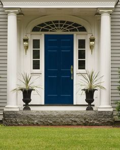 Love the grey house with a bright blue door.