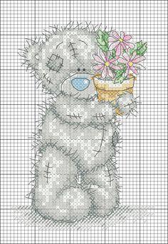 Teddi orso e un vaso di fiori