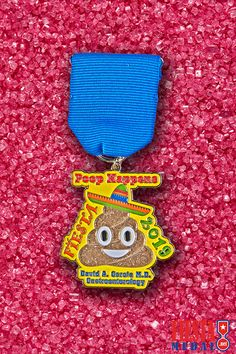 To celebrate World Emoji Day, we are showcasing this fiesta medal we created for gastroenterologist David A. Garcia M.D. 💩🎉