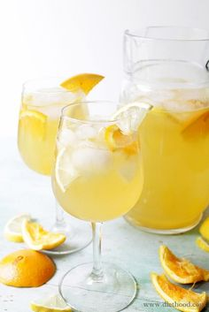 White Sangria:: Fresh and fruity White Sangria made with white wine, triple sec, fresh orange juice and lemon juice.