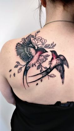Two stunning swallows with lined flowers by Dave. #swallowTattoo #backTattoo