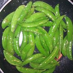 """Mediterranean Snow Peas: """"This takes 5 minutes in a pan. You want to barely cook these as noted to keep the lightly crunchy natural sweetness of this seasonal delicacy!"""