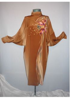 1980s Floral Silk Dress Designed by Yolanda and sold at I.Magnin.  This particular dress is typical of the 1980s with batwing sleeves and drop shoulder seams. The beautiful silk used for this garment is done in shades of warm cocoa brown with the most wonderful hand-painted Orchid design.