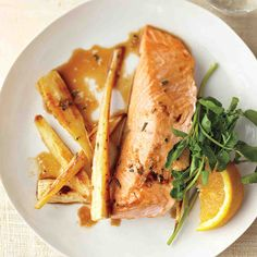 Ginger gives a zing to roasted salmon's delicate flavor. Serve this dish with a wedge of orange for squeezing over the fish along with a fresh green, such as watercress, for its bite.