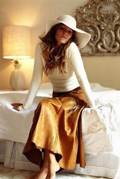 Cream sweater...leather skirt...hat...love it.