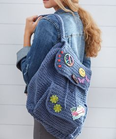 Patch Backpack free crochet pattern in Comfort yarn. Crochet this fashion-right backpack and then personalize it with purchased patches and trims that speak to you (so to speak). Crochet Backpack Pattern, Crochet Purse Patterns, Crochet Bows, Bag Pattern Free, Crochet Purses, Diy Crochet, Bag Patterns, Sewing Patterns, Mochila Crochet