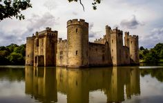 The beautiful 14th-century Bodiam Castle is a moated castle in Sussex, England. Is said to be a perfect example of late medieval moated castles.