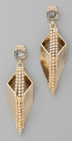 Drop earrings. At least one really good pair. Pick something with multiple metals and plain stones for versatility. simone crystal geometric drop earrings.