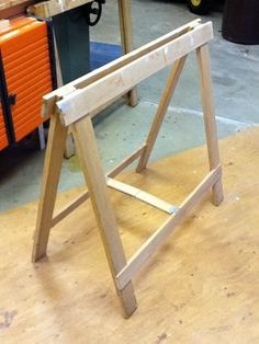 Sturdy folding sawhorse holds lots of weight and stores easily in small space.  Great for quick tables or work spaces.