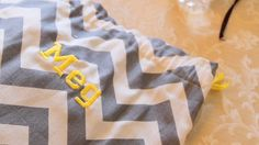 This is a cute way to wrap your wedding gifts for your wedding party - Personalize a bag to hold the gift for your bridesmaid--chevron in grey and yellow.