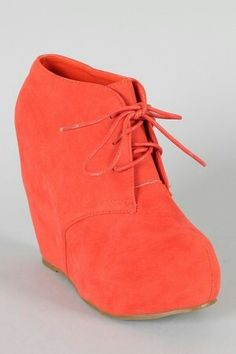 Bright coral suede wedges with a lace up front.