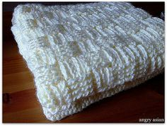 Basket weave crocheted baby blanket with link to a pattern.