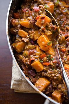 "Cheesy Sweet Potato ""Skillet Chili"" with Lean Ground Beef, Red Bell Peppers, Tomatoes and Red Beans, with Sharp Cheddar and Green Onions"