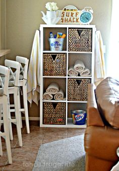 IKEA Kallax shelving used as towel, sunscreen, and bathing suit pool Storage