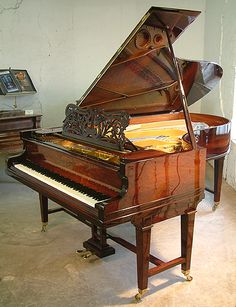 A Bechstein Model C grand piano with a rosewood case and gate legs at Besbrode Pianos