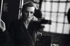 Photographed in black and white, Kate Winslet models M. Martin trench coat