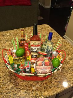 """Have A Merry Christmas & A Bloody Good New Year!"" -- Bloody Mary / Maria Holiday Gift Basket -- & yes I made this one with vodka & tequila! If you have never had a Bloody Maria (sub tequila for vodka), please try it. Gives it even more zing! Fill the basket with whatever sounds good to you for a Bloody Mary. This one has Mix, beer, lemon & lime, Frank's Red Hot, Bacon Salt, black pepper, horseradish, pickled okra, green olives, Slim Jims, toothpicks, & straws."