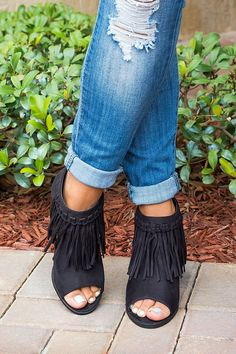 "Theses fringed booties pair perfectly with everything, for a trend-right appeal. Great with jeans and dress! Features: - Fringed detailing at front with open sides - Back zipper closure - 3"" heel stac"