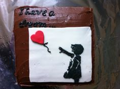 """Banksy Cake for a local community art project called """"I Have a Dream"""" using frozen buttercream transfer to create the artwork"""