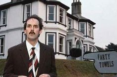 Basil Fawlty of Fawlty Towers.  British humour... Snort, giggle, guffaw. Love that sh*t!
