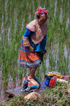 Hmong Woman washing clothes in the river, Vietnam