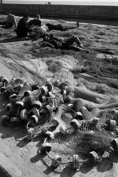 Magnum Photos-  View image only Ara Guler TURKEY. 1965. Men sleeping among the nets at Kumkapi.