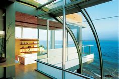 Curved Glass Hallway - luxesource.com