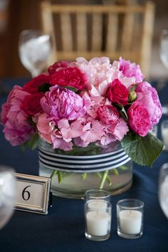 Pink arrangement in vase wrapped with navy ribbon. Photography by lindsayflanagan.com, Floral Design by hanafloraldesign.com