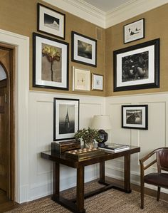 Mark Cunningham Inc.  I like the High Wainscoting with Pictures Hung above, and below...