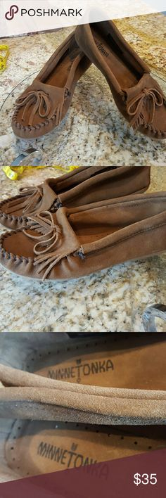 Minnetonka Moccasins 7 New This is a brand new pair of moccasins that I've never worn. They are made out of a quality suede and a beautiful caramel brown color. They are size 7 and with socks seems true to size. If wanting to wear with bare feet these might be a little loose. They have very pretty detailing with a fringe and bow and whip stitch detailing. They have a durable rubber sole. These come from a smoke-free environment. I ship same or next day. Minnetonka Shoes Moccasins