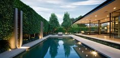 —An extensive open-plan extension to this grand 1930s home was given a rear garden that blurred the line between inside and out, with a stunning pool and entertainment area. Working closely with Catt Architects, this outdoor space and new extension were conceived as one. The decking was therefore an extension of the home, which in turn linked with the pool, surrounded by frameless glass and featuring a dark tile providing reflective qualities. The formal design elements included a boundary…
