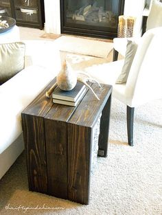 DIY side table from Thrifty & Chic. I love the dark stained wood. and that is the exact same couch I have! :)