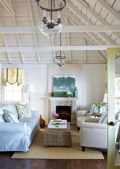 sweet swoon-worthy coastal style - love the ceiling, the coir matting / rug, the casual nautical decor and sofas and the chandelier