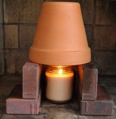 Terra cotta pot heater | 36 Cold Weather Hacks to Keep You Cozy This Winter