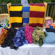 At the Waterfront Market. It is a chilly morning, I might start selling the winter stuff today. Chair Socks, Green Slippers, Host Gifts, Skinny Scarves, Knit Dishcloth, Primary Colors, Hand Knitting, Colours, Crochet