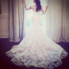 Fitted lace wedding dress with sleeves and long train. Gorgeous!