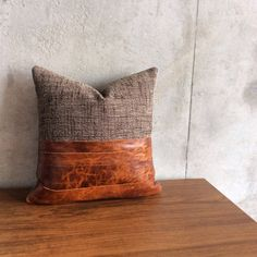 "This pillow is made using a tough boucle commercial grade fabric and authentic ""pull"" leather (it will patina over time).  The pillow measures 16.5""x16.5"" and is shown with an 18"" x 18"" feather insert (included)  I made this pillow in Atlanta. If you are in town and would like to pick it up I'm happy to waive shipping charges."