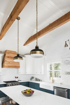 Farmhouse Kitchen with beams and shiplap Farmhouse Kitchen features painted shiplap and beams on a vaulted ceiling #farmhousekitchen #farmhousekitchenshiplap #beams #ceiling #farmhousekicthen #farmhousekitchenceiling #shiplap
