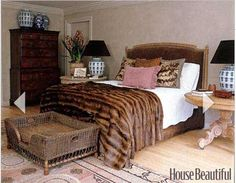 Looks like the dog sleeps at the foot of this bed -- and his basket is on top of the area rug!