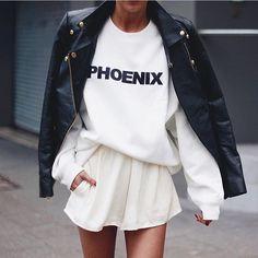 White pleated skirt + sweatshirt and black leather jacket