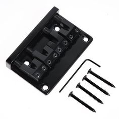 1pc BA-1004BK L Shape Saddle Black 4 String Bass Bridge for Bass Guitar. Chrome. Item 100% like the picture shown. 100% new. high quality and testing is fine. Package Included:. String space: 18mm. We manufacture all kinds of instrument parts and conduct The direct model so that our price is very low with high quality. Material: Metal. Size: 79.5 x 51.5 mm. 1 x black bass bridge(Allen wrench and screws are included). L Shape Saddle Bridge for 4 String bass guitar.
