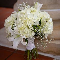 Real Weddings - In Bliss Weddings: Megan Lucas. The bride's enchanting bouquet consisted of white hydrangeas and casablanca lilies. Spring Wedding Flower Inspiration, Spring Wedding Flowers, Flower Bouquet Wedding, Flower Bouquets, Bridal Bouquets, White Hydrangea Bouquet, White Bouquets, White Hydrangeas, Big White Flowers