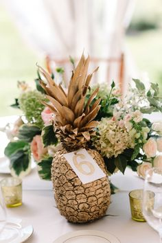 Pretty gold pineapple table accents: http://www.stylemepretty.com/new-jersey-weddings/chesterfield-township-new-jersey/2016/02/02/garden-party-inspired-wedding-infused-with-pineapples/ | Photography: Michelle Lange - http://www.loveandbemarried.com/