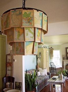 vintage map chandelier.  Use an old chandelier frame, pot rack, or even a bicycle wheel