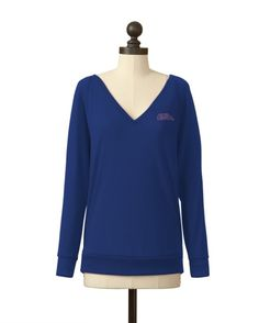 Our casual v-neck pullover sweater is one you'll soon want to wear every day. Meesh & Mia's ultra-soft sweater knit is the perfect weight, feel and look for your soon-to-be favorite sweater. - Made in the USA - School Logo is a crystal logo on the left chest - 77% Polyester, 19% Rayon, 4% Spandex - Machine Wash Cold, Gentle Cycle, Do Not Bleach, Line Dry, Cool Iron When Needed - Officially Licensed Product