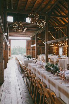 Elegant table for wedding reception in barn