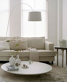 calm white colour palette and fabulous arc lamp