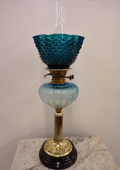 Rare Teal Blue OIl Lamp. Very unusual teal blue shade and font the progresses from the deeper color st the top ro a light blue below. Circa 1880-1900